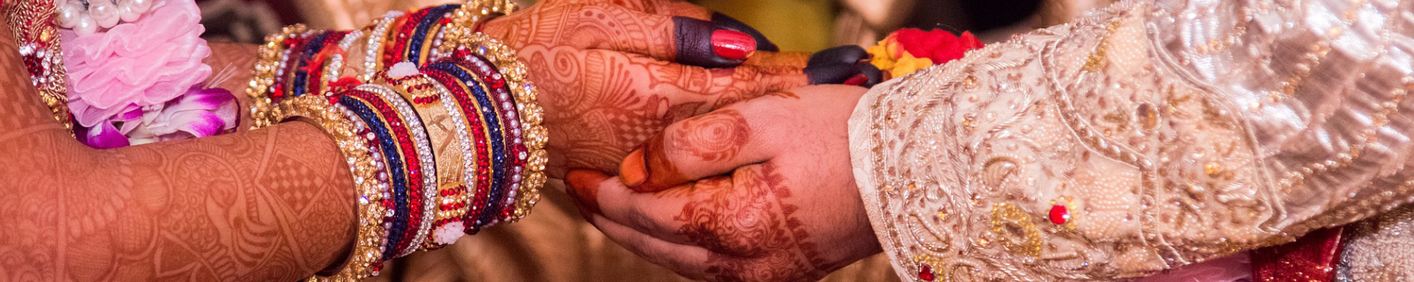 couple holding hands at marriage ceremony in India